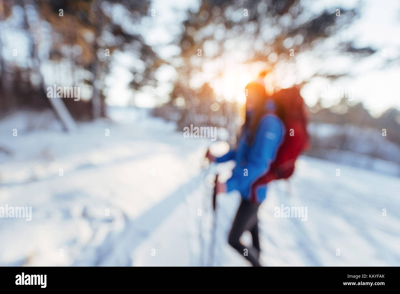 Woman Traveler out of focus with backpack hiking Travel Lifestyle adventure concept active vacations outdoor. - Stock Image