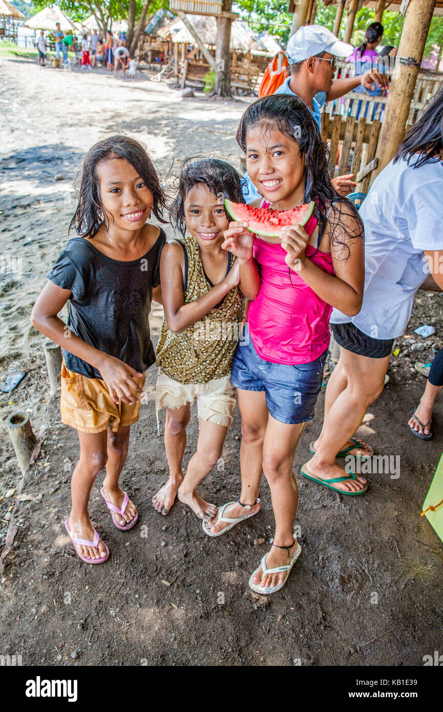 Three young filipino girls at the beach eating watermelon in ormoc three young filipino girls at the beach eating watermelon in ormoc city leyte island philippines altavistaventures Image collections