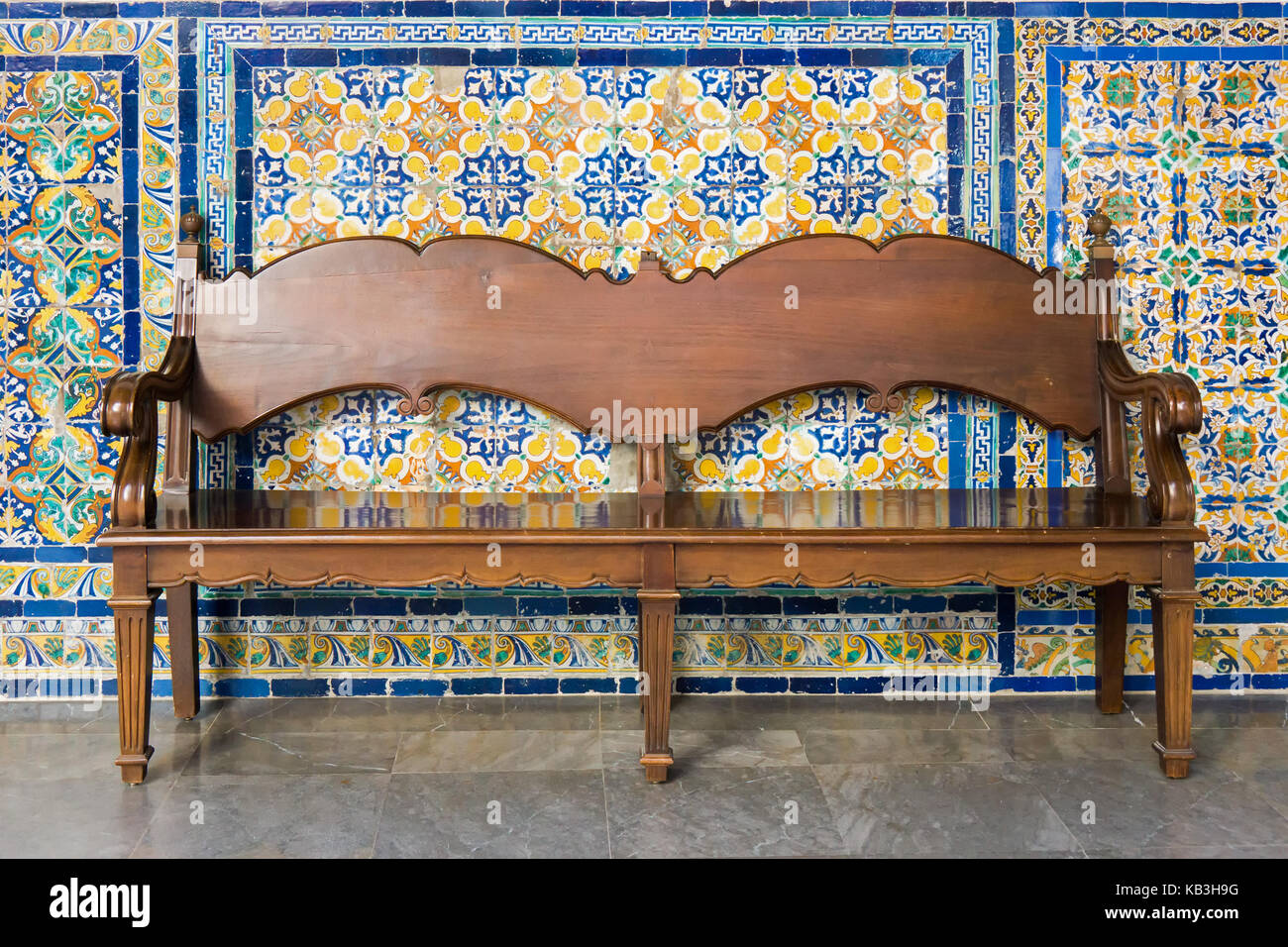 Tremendous Old Wooden Bench With A Background Of Ceramic Tiles Stock Spiritservingveterans Wood Chair Design Ideas Spiritservingveteransorg
