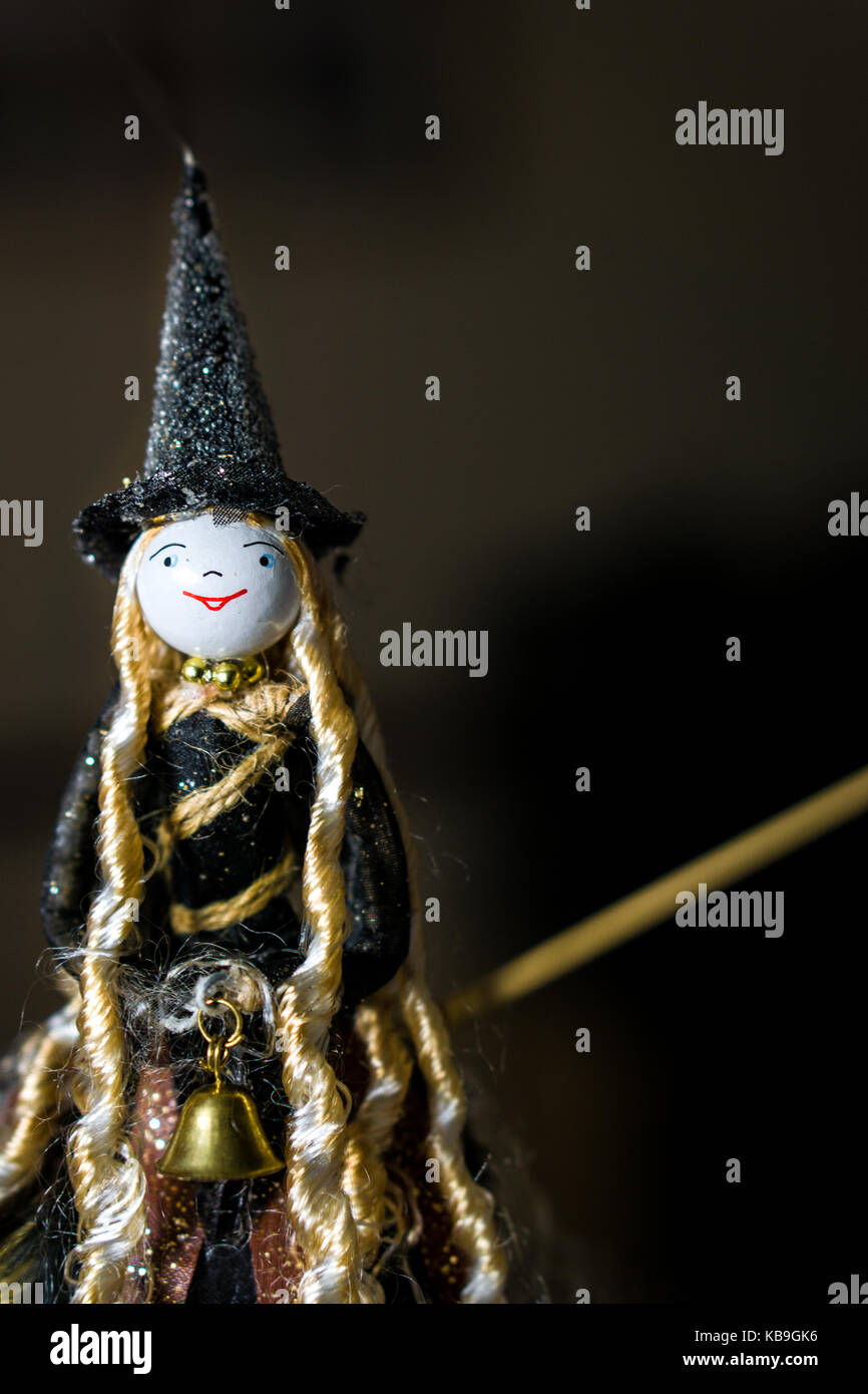 witchcraft doll on broomstick ready for halloween stock photo