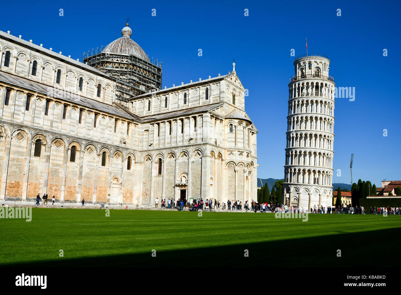 Side view of the Pisa Cathedral with the Leaning Tower of Pisa in the background, Pisa, ItalyStock Photo