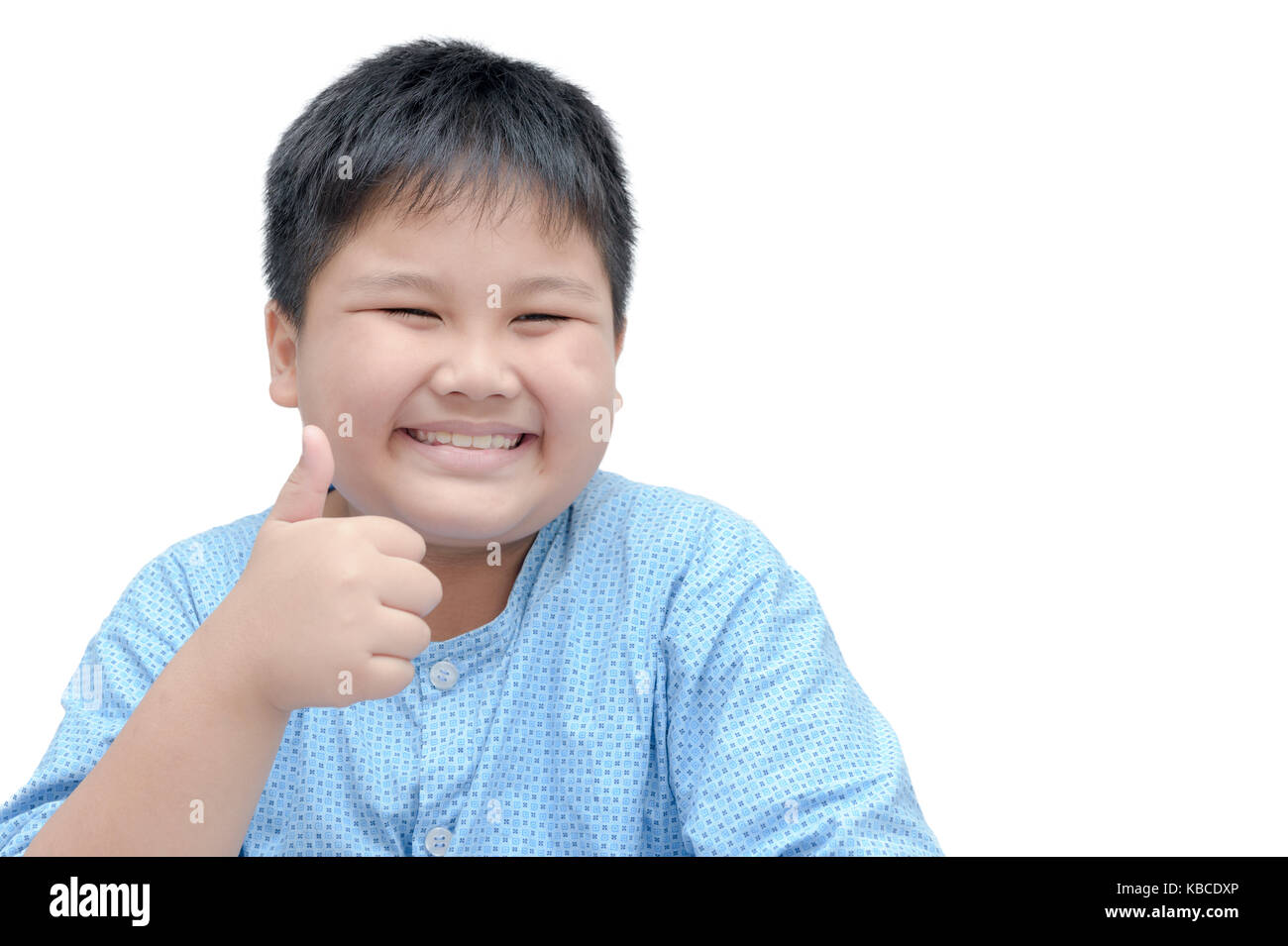 Portrait of asian happy fat boy showing thumbs up gesture, isolated over  white background