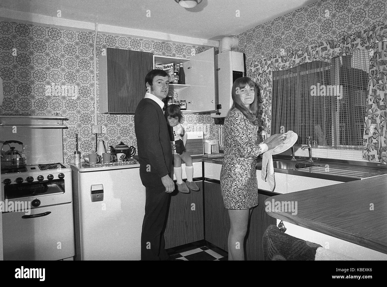 1972, historical, husband and wife with child in the kitchen of their recently renovated council flat, Baildon Street, - Stock Image