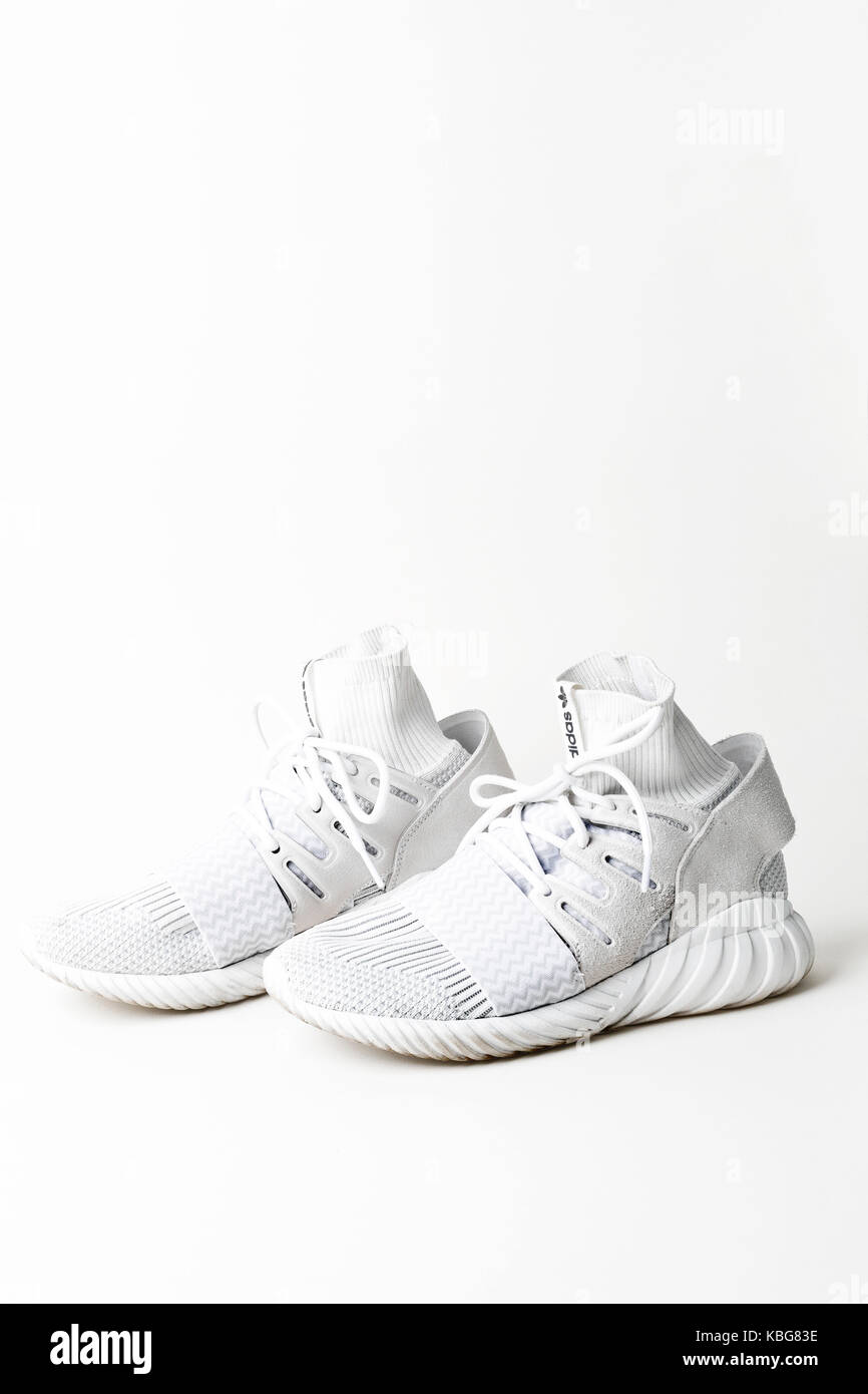 White Adidas male shoes on white background - Stock Image