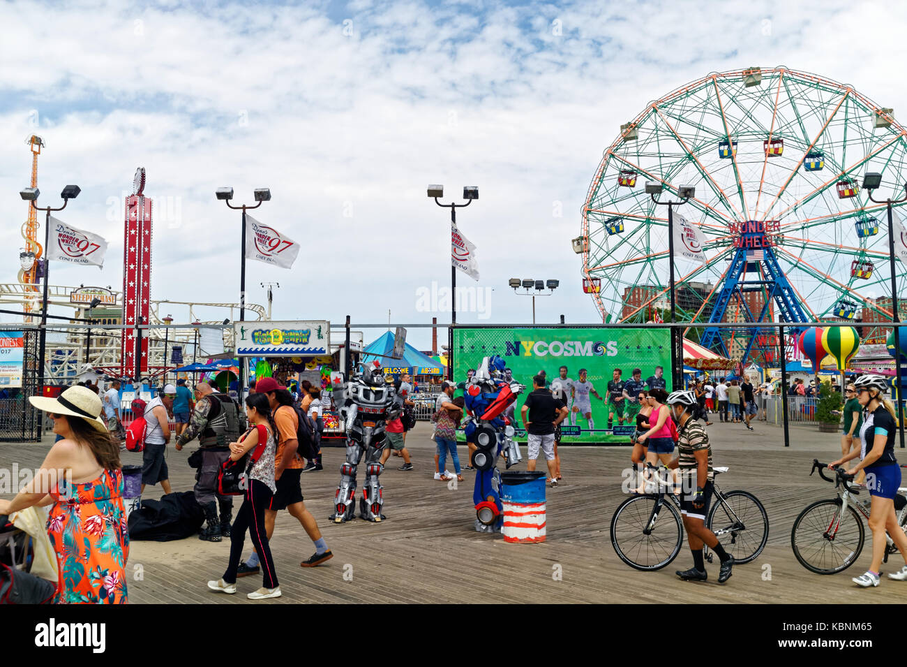 Boardwalk, amusement park featuring the famed Wonder Wheel in Coney Island. - Stock Image