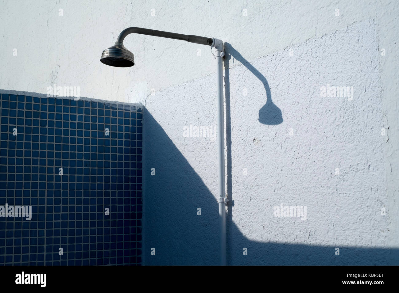 Outdoor shower by a pool at Hotel Ninays in Lloret de Mar, Spain Stock Photo