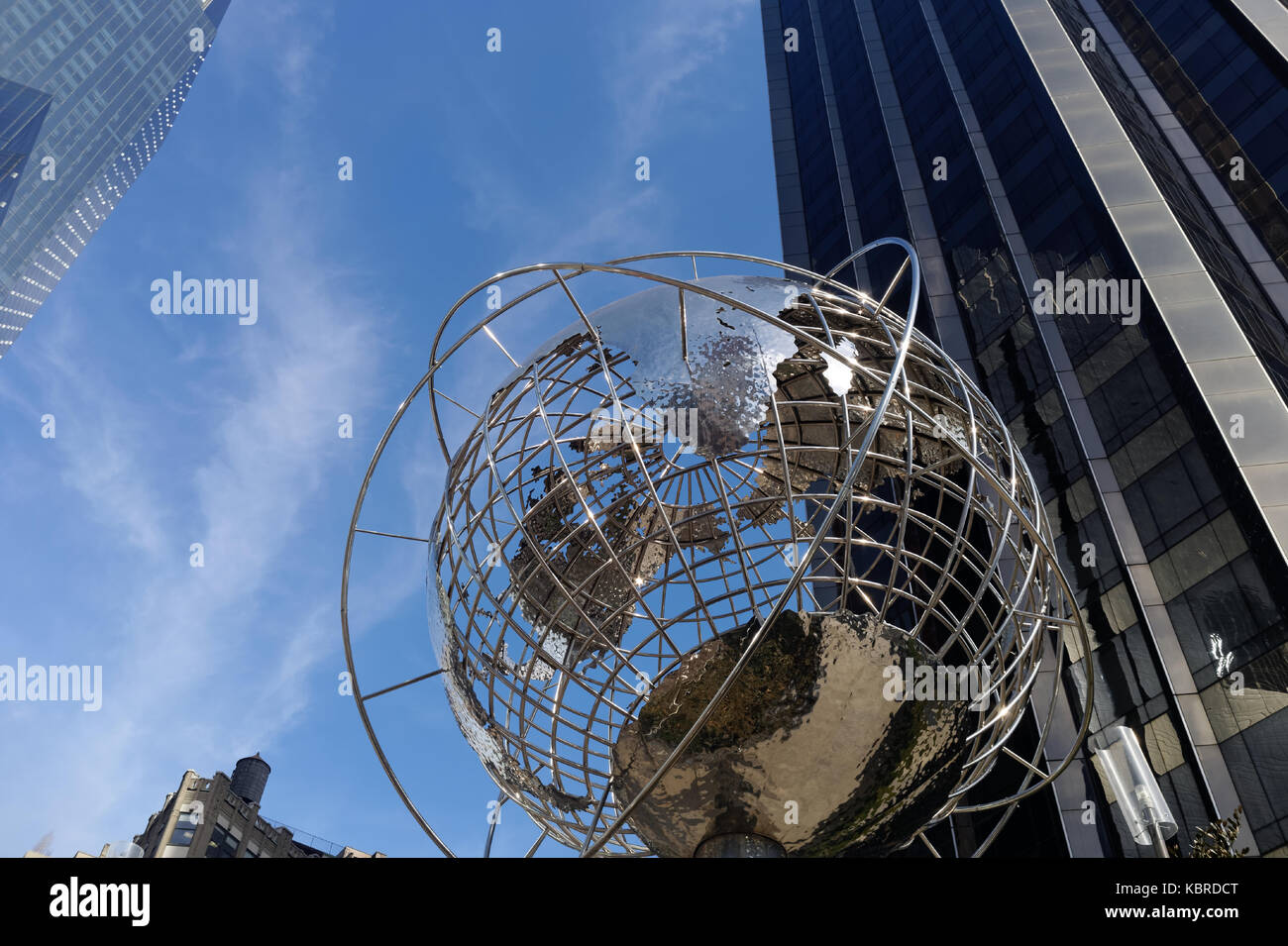 Silver earth globe by the Trump International Hotel and Tower located between Broadway and Central Park West on - Stock Image