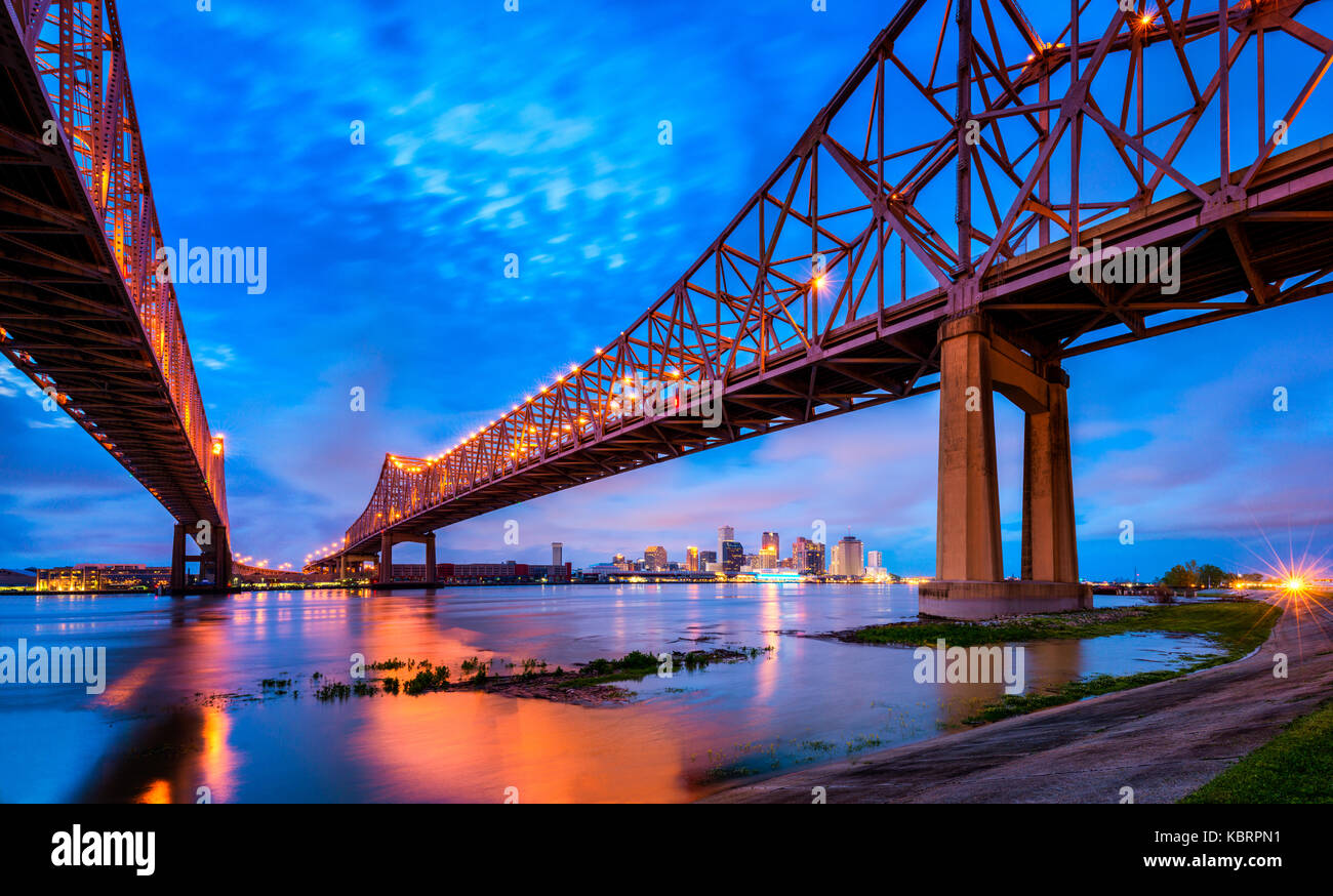 Skyline of New Orleans with Mississippi River at Dusk - Stock Image