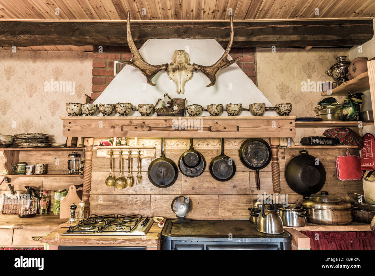 Rustic style kitchen with pots and pans - Stock Image