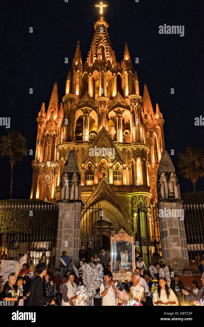 Devotees carry the statue of Saint Michael on their shoulders from the Parroquia de San Miguel Arcangel church during - Stock Image