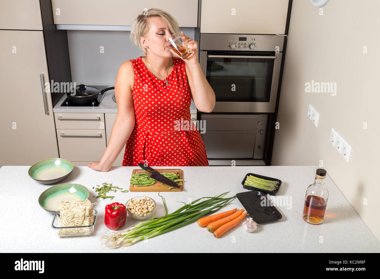 Cooking can wait if you need to drink some whiskey - Stock Image