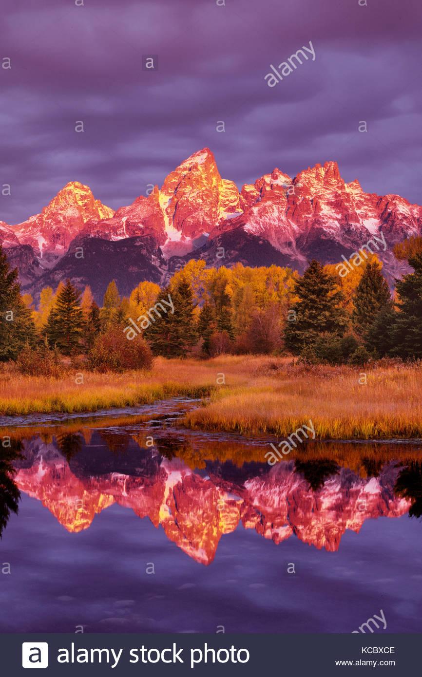 Teton Range at Dawn, Reflected in the Snake River, Grand Teton National Park, Wyoming - Stock Image