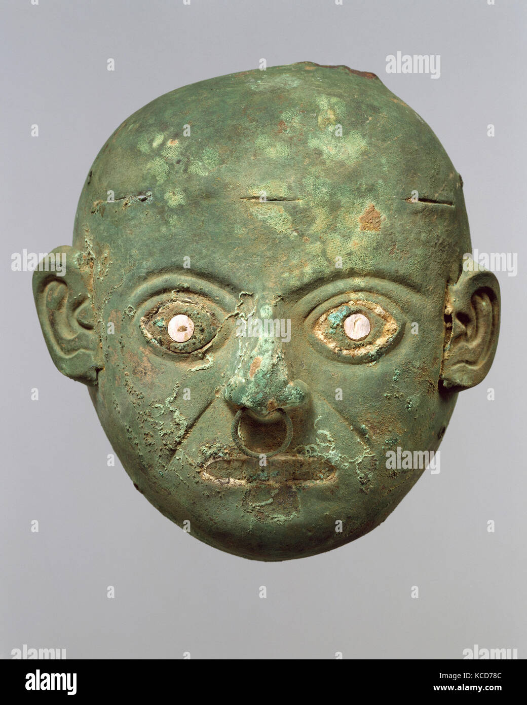 Mask, 2nd–3rd century, Peru, Moche, Copper, shell inlays, H. 8 x W. 7 1/2 in. (20.3 x 19 cm), Metal-Ornaments - Stock Image