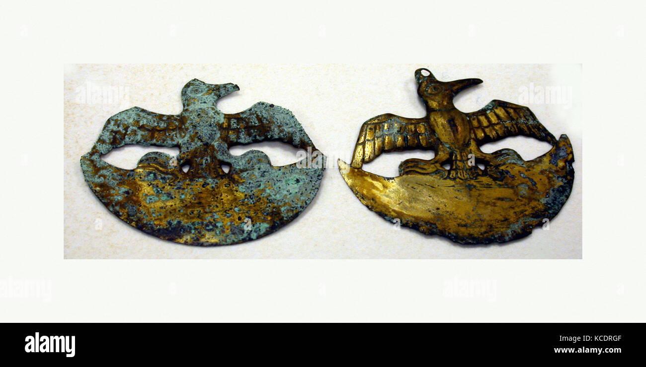 Crescent Ornament, 390–450, Peru, Moche (Loma Negra), Gilded copper, H. 1 7/8 x W. 2 3/16 in. (4.8 x 5.5 cm), Metal - Stock Image