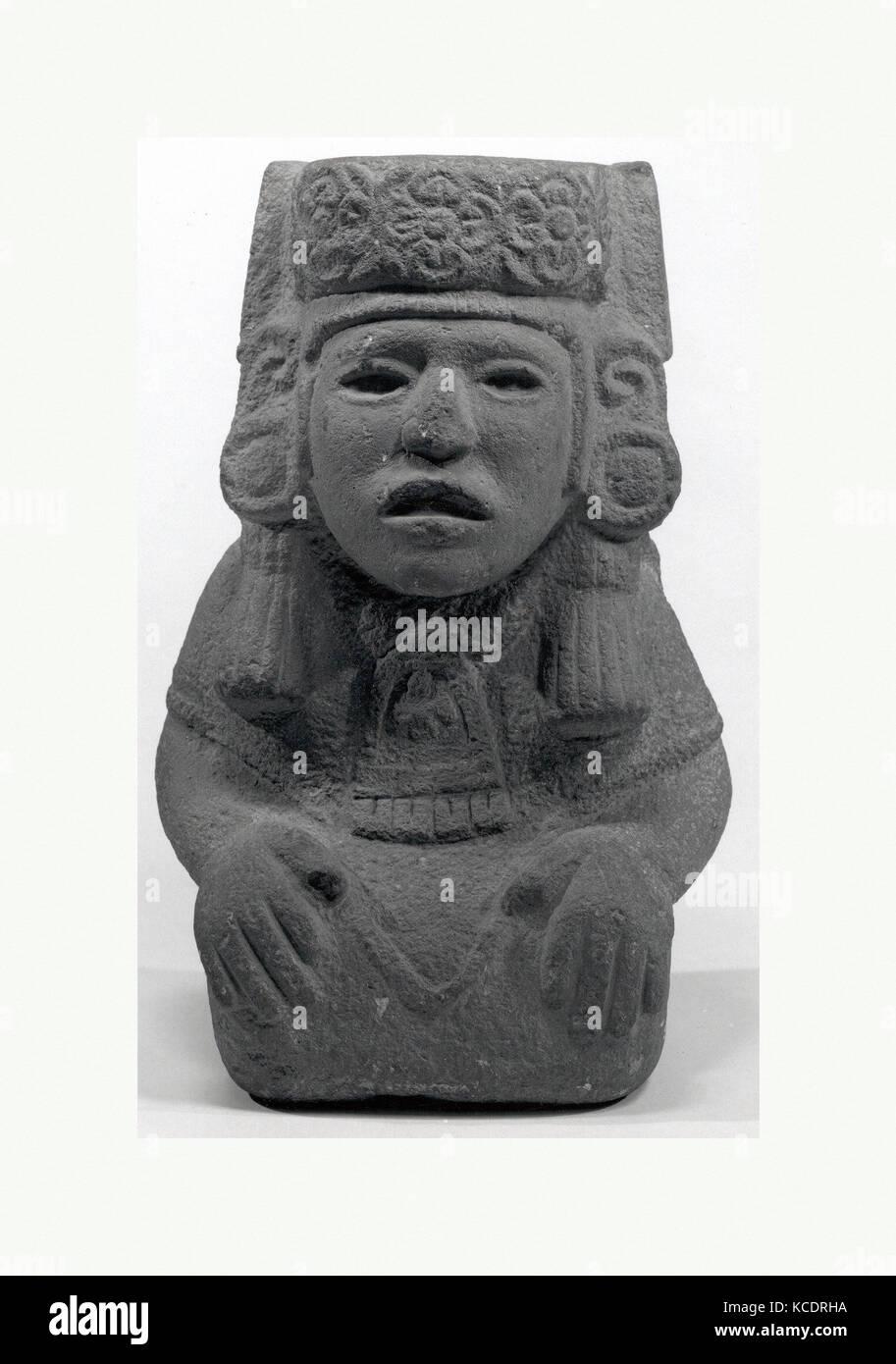 Seated Female Deity, 15th–early 16th century, Mexico, Mesoamerica, Aztec, Stone, H. 12 1/4 x W . 7 1/2 x D. 5 1/2 - Stock Image