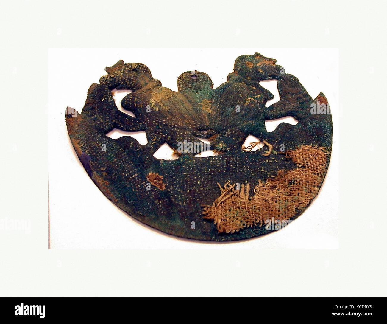 Animal Ornament, 390–450, Peru, Moche (Loma Negra), Gilded copper, H x W: 4 1/8 x 4 15/16in. (10.5 x 12.6cm), Metal - Stock Image