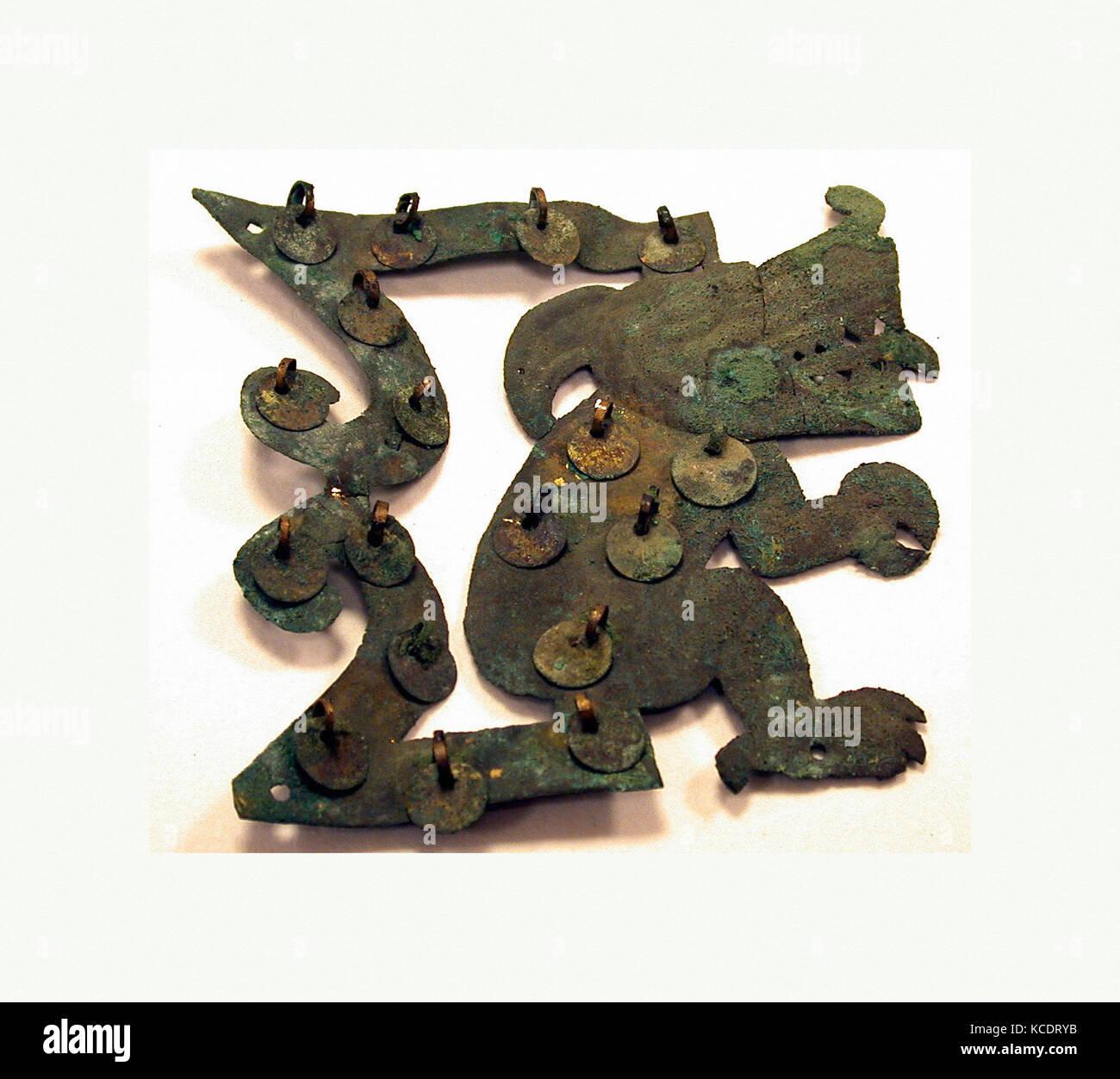 Animal Ornament, 390–450, Peru, Moche (Loma Negra), Gilded copper, H x W: 4 1/2 x 4 7/16in. (11.4 x 11.3cm), Metal - Stock Image