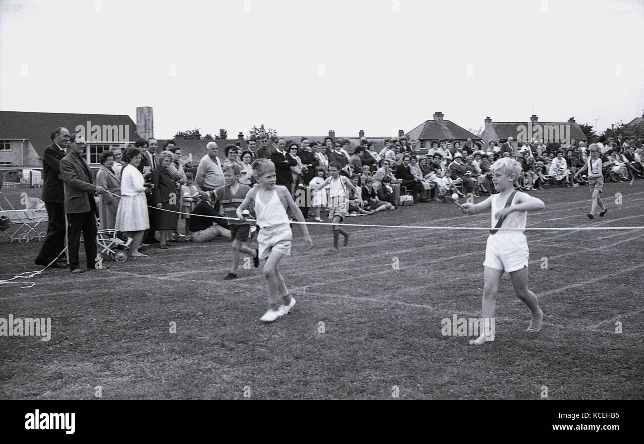 1960s, historical, young boys competing in an egg-and-spoon race at a schools' sports day, Dorchester, England, - Stock Image