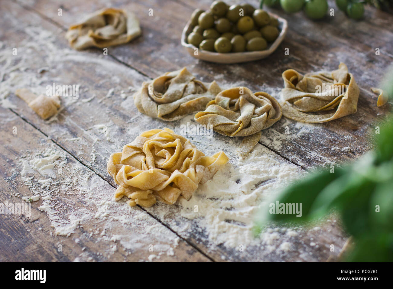 Raw homemade pasta on the old wooden table - Stock Image