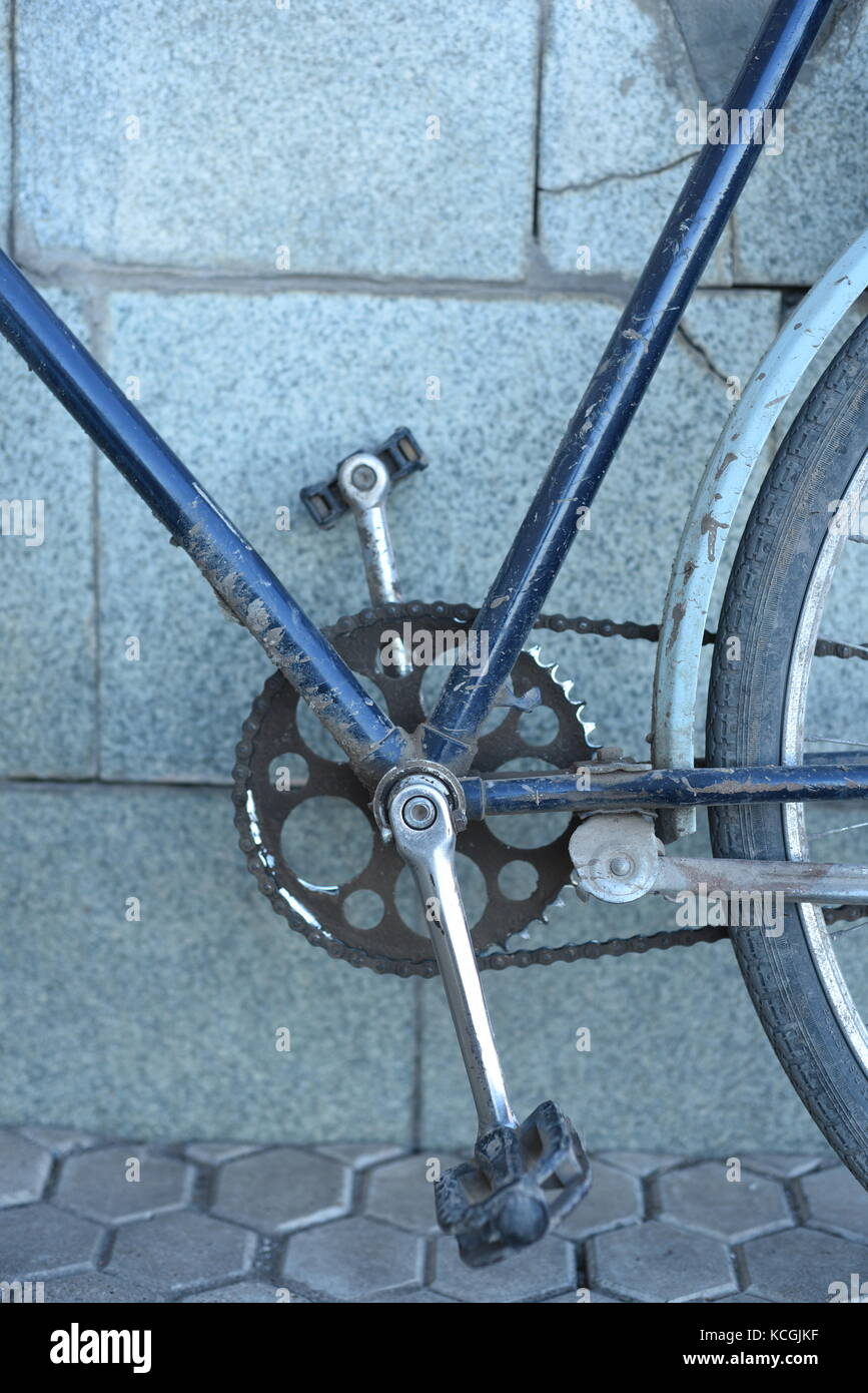 Closeup of an old blue vintage retro bicycle with pedals and chain