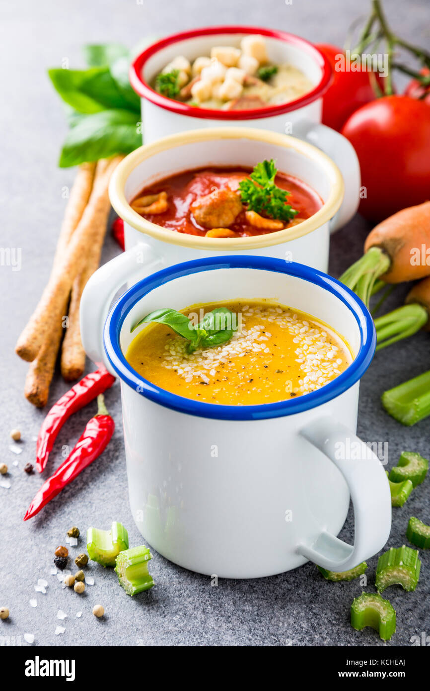 Homemade assorted soups with ingredients - Stock Image