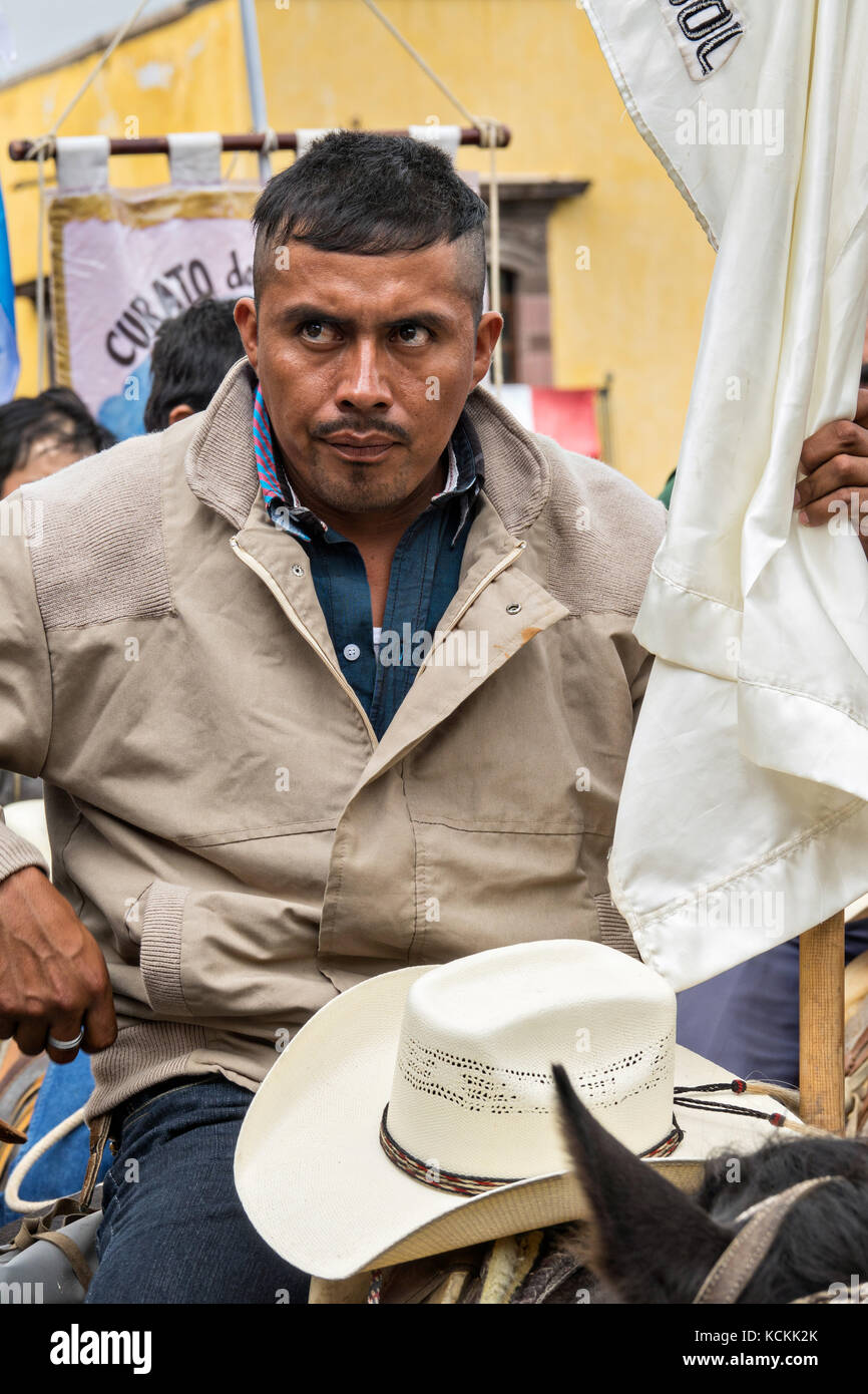 Mexican cowboys gather on horseback for Catholic Mass in the Jardin Allende at the end of their pilgrimage celebrating - Stock Image