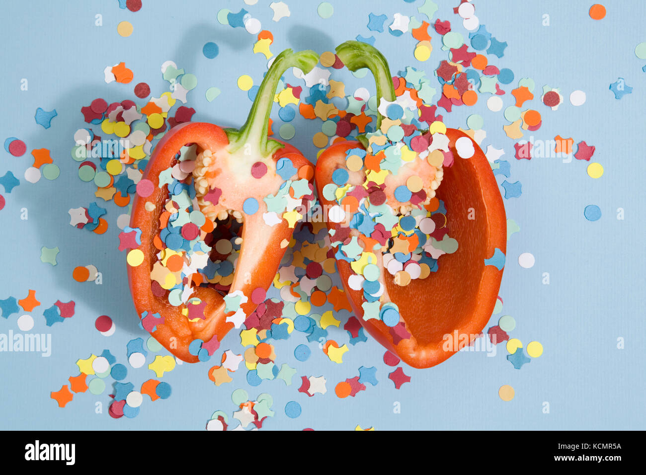 Minimalist and poetic composition of a red peper like a pinata Minimal color still life photography - Stock Image