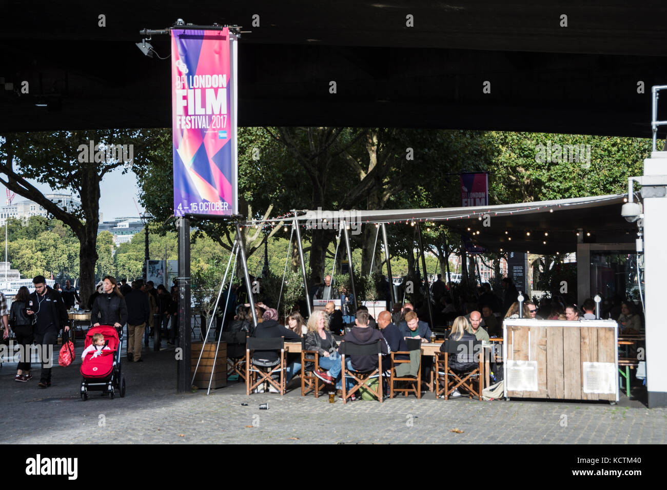 People socialising outside the British Film Institute at the National Film Theatre on London's  South Bank, - Stock Image