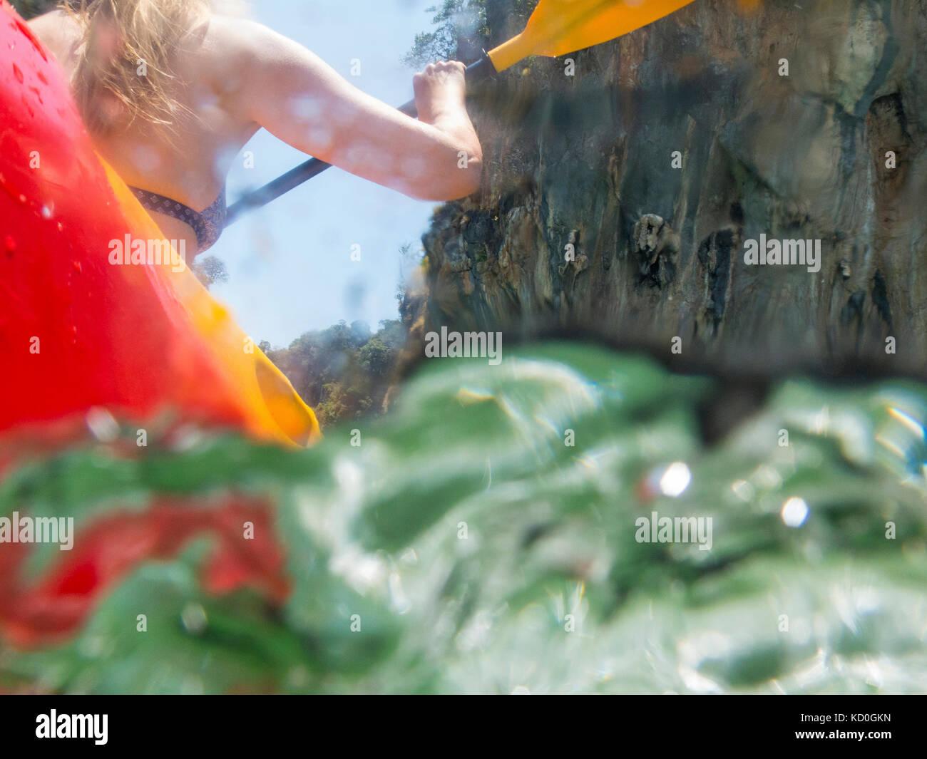 Rear view of woman sea kayaking, Koh Hong, Thailand, Asia - Stock Image