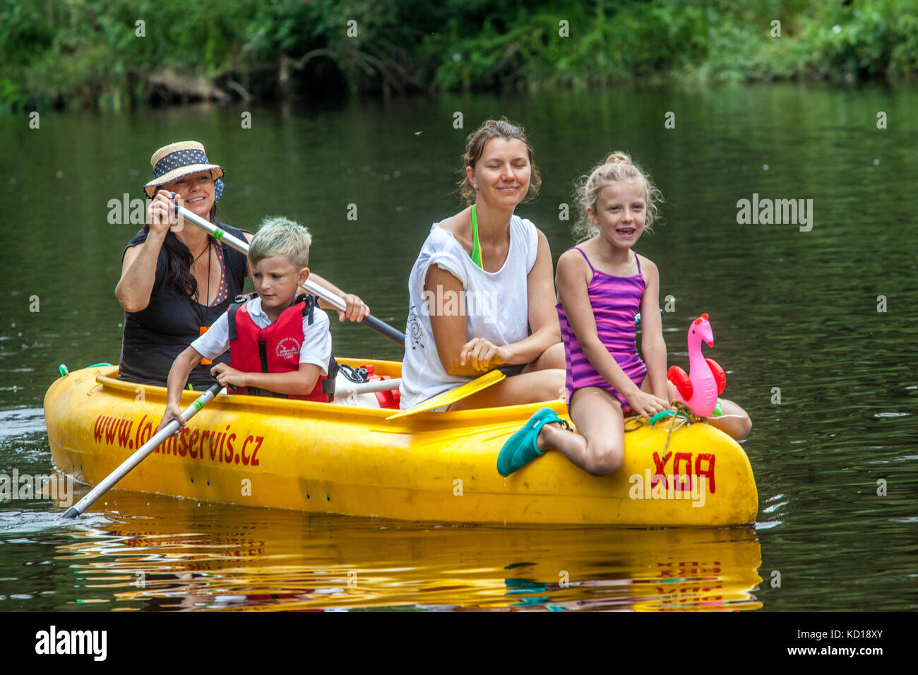 Canoe with three generation paddlers going down by  Otava river, Vacations in summer, Czech Republic - Stock Image