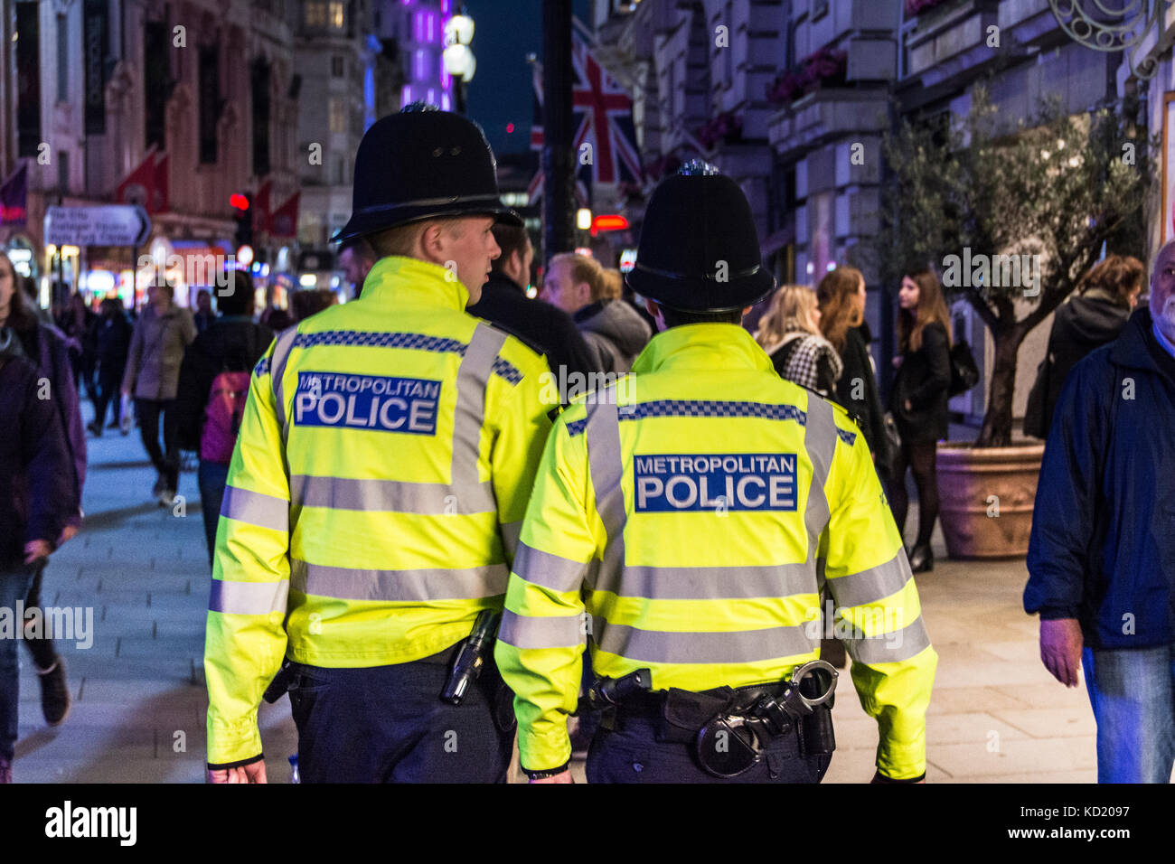 Two 'Bobbies' patrolling their beat in Piccadilly Circus, London, UK Stock Photo