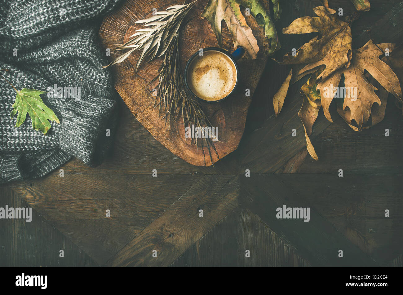 Autumn morning coffee concept with leaves and jamper - Stock Image