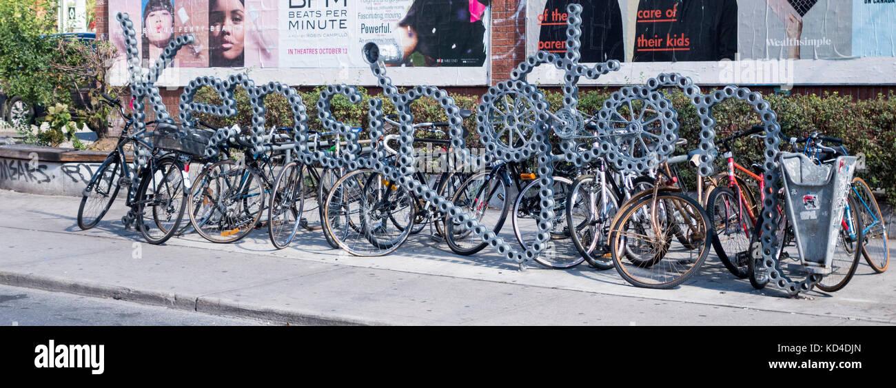 bicycle-rack-shaped-like-bicycle-chain-spelling-kensington-in-kensington-KD4DJN.jpg