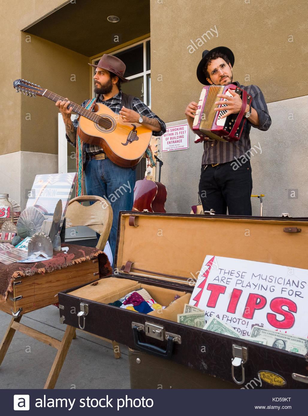 Two musicians performing acoustic music for tips at the Saturday Farmers Market, Santa Fe Railyard, Santa Fe, Santa Stock Photo