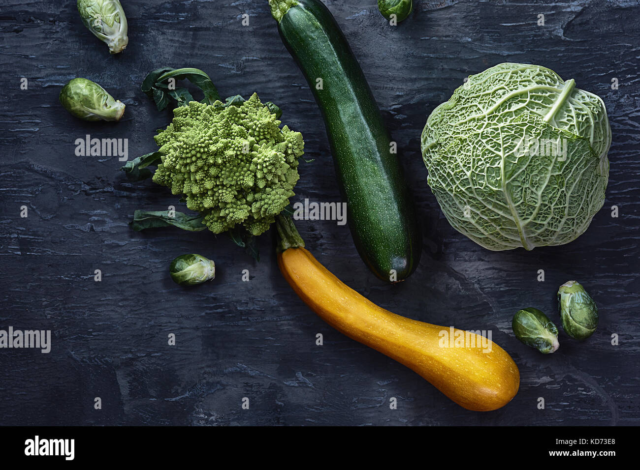 Organic vegetables on wooden table. Top view - Stock Image