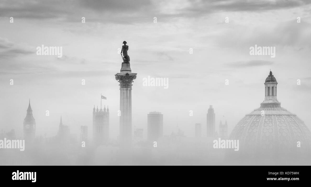 Nelsons Column in Trafalgar Square Houses of Parliament and the dome of the National Gallery in London UK - Stock Image