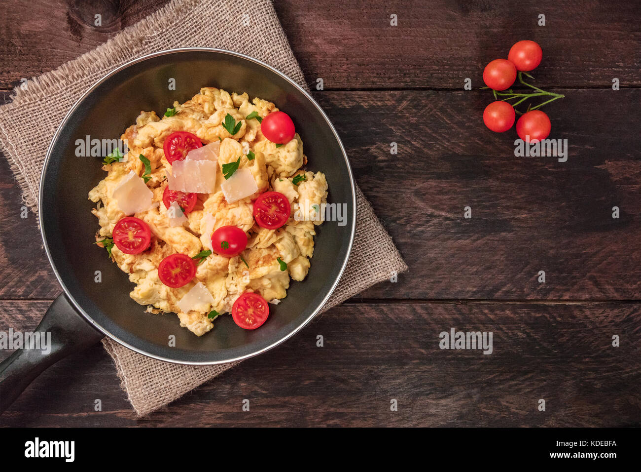 Scrambled eggs in skillet with copy space - Stock Image