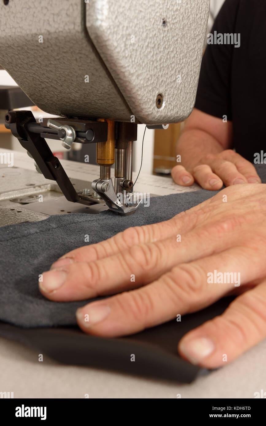 sewing machine machines needle needles sew thread stitch stitching - Stock Image