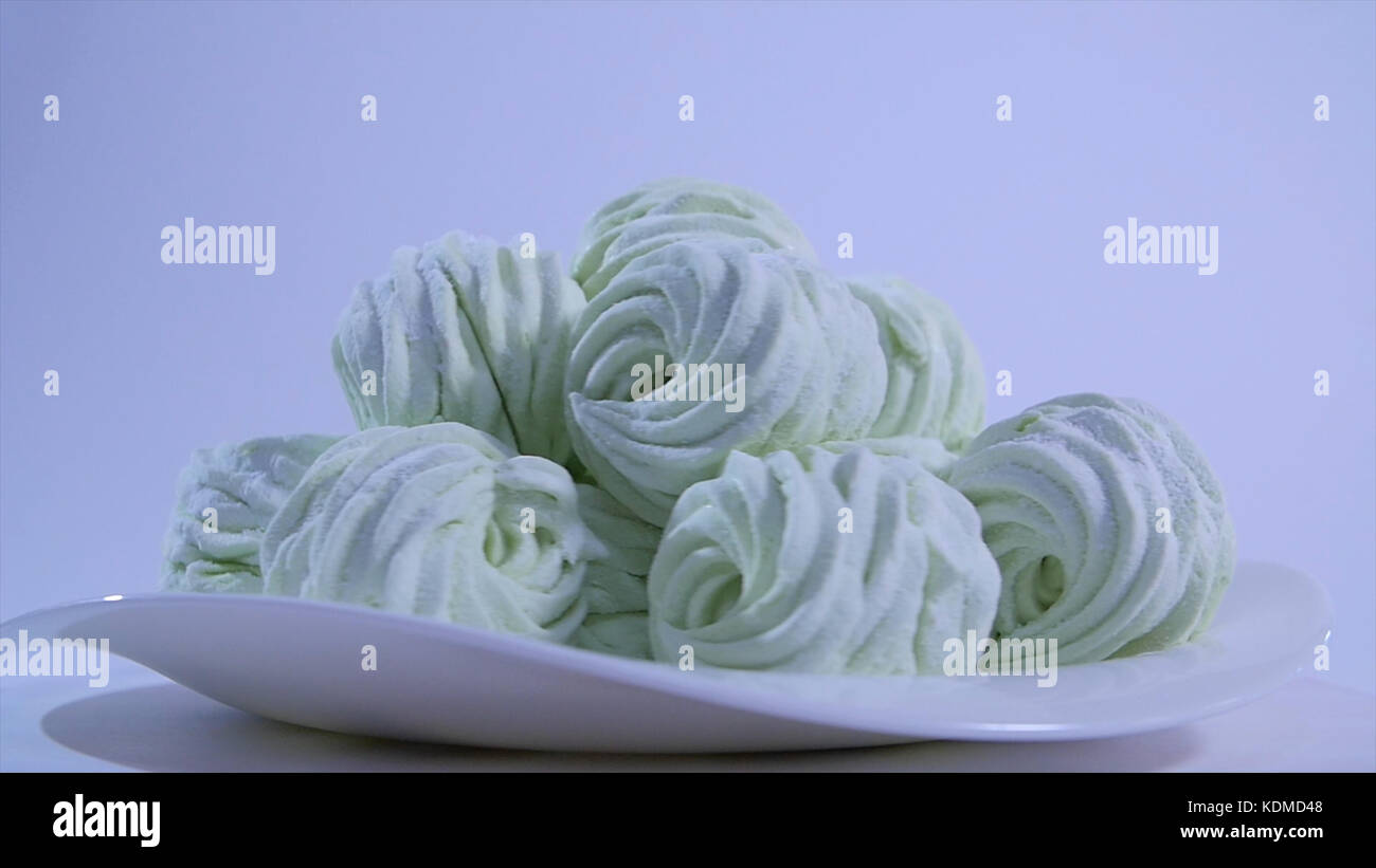 Lots of little marshmallows. marshmallows on white background. Pink Fluffy Round Marshmallows as a background. Sweet - Stock Image