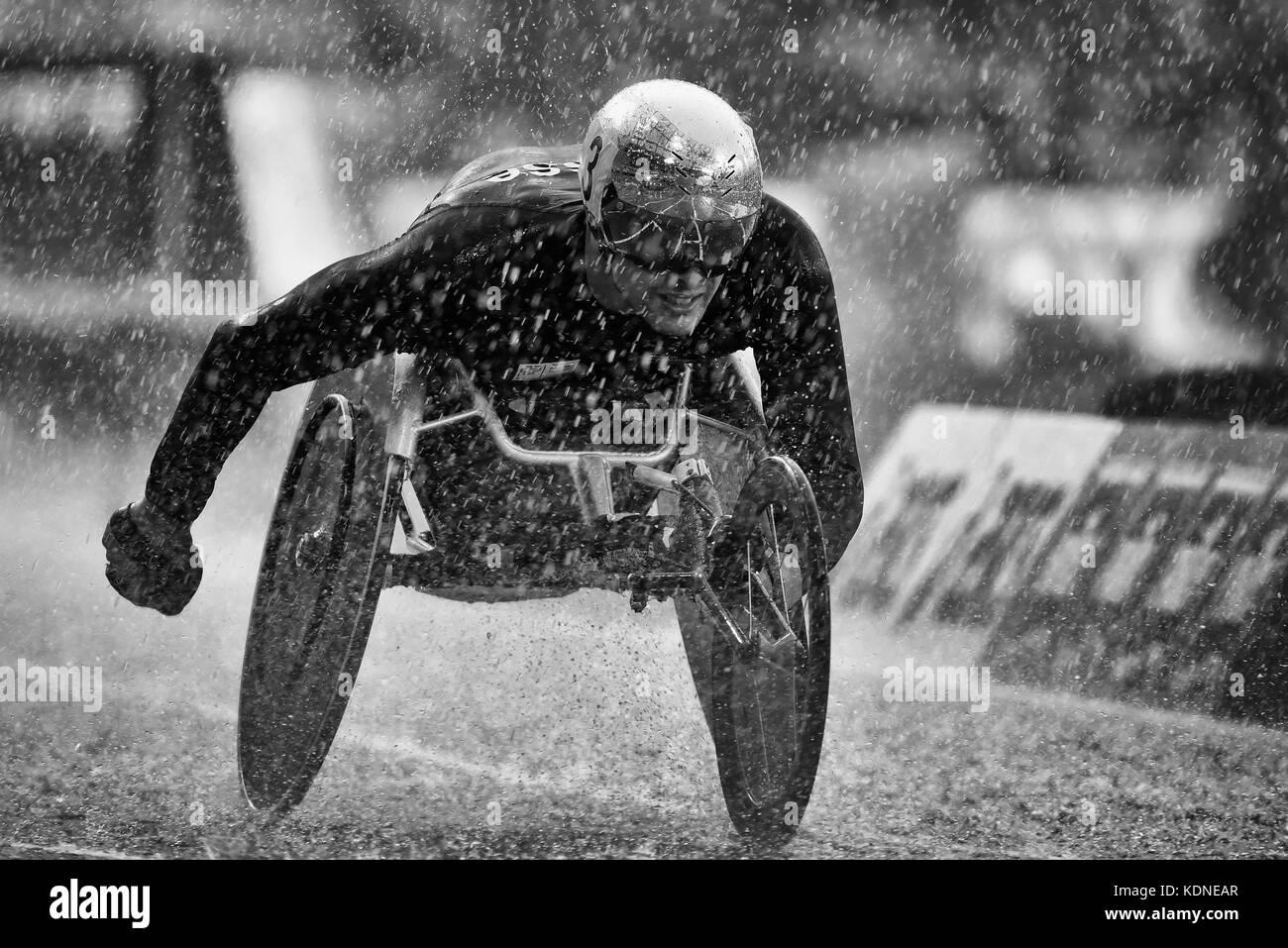 Marcel Hug wheelchair athlete competing in wet 5000m T54 final at the World Para Athletics Championships in the Stock Photo