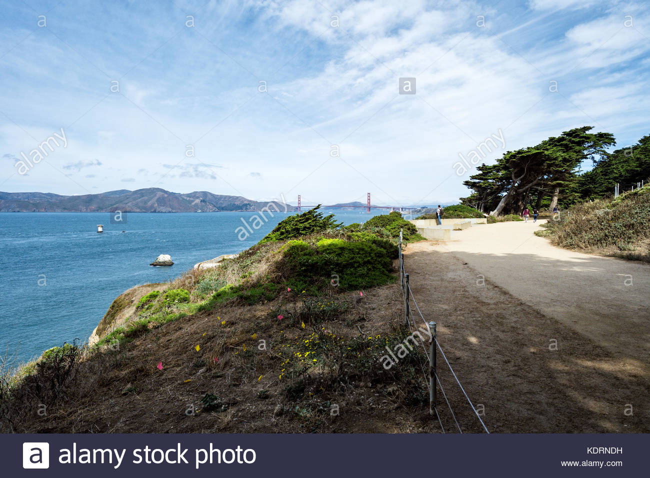 Tourists below USS San Francisco Memorial enjoy Eastern Coastal Trail and Overlook at Land's End, San Francisco,Stock Photo