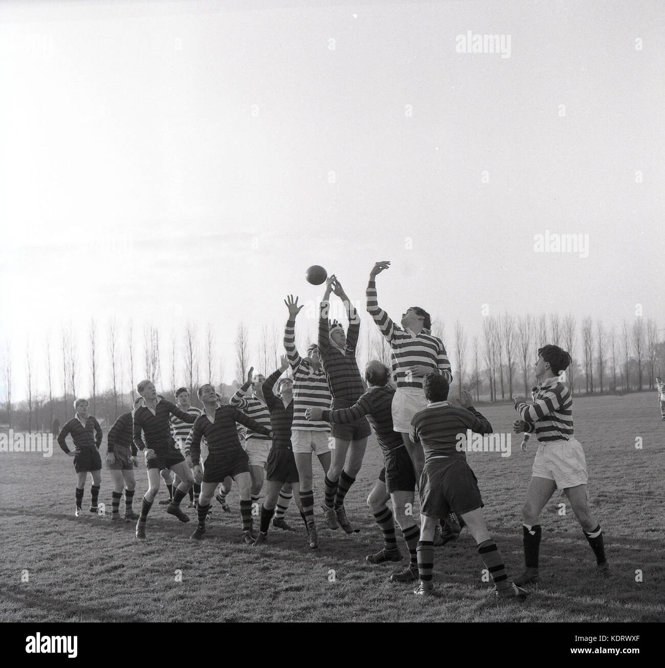 1960s, historical, picture shows an amateur rugby union match and the the two teams forwards competing for the ball - Stock Image