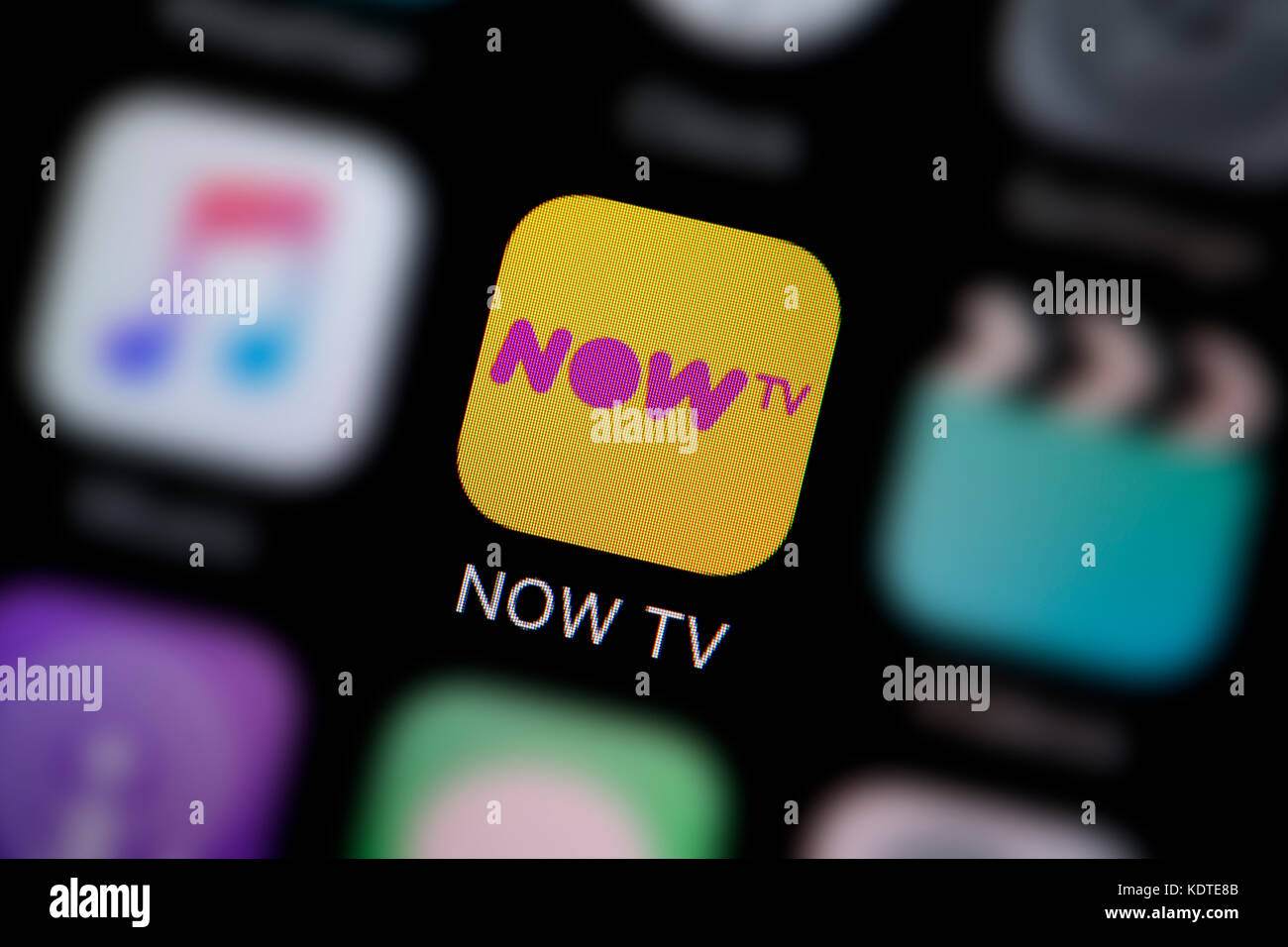 A close-up shot of the logo representing the NOW TV app icon, as seen on the screen of a smart phone (Editorial Stock Photo