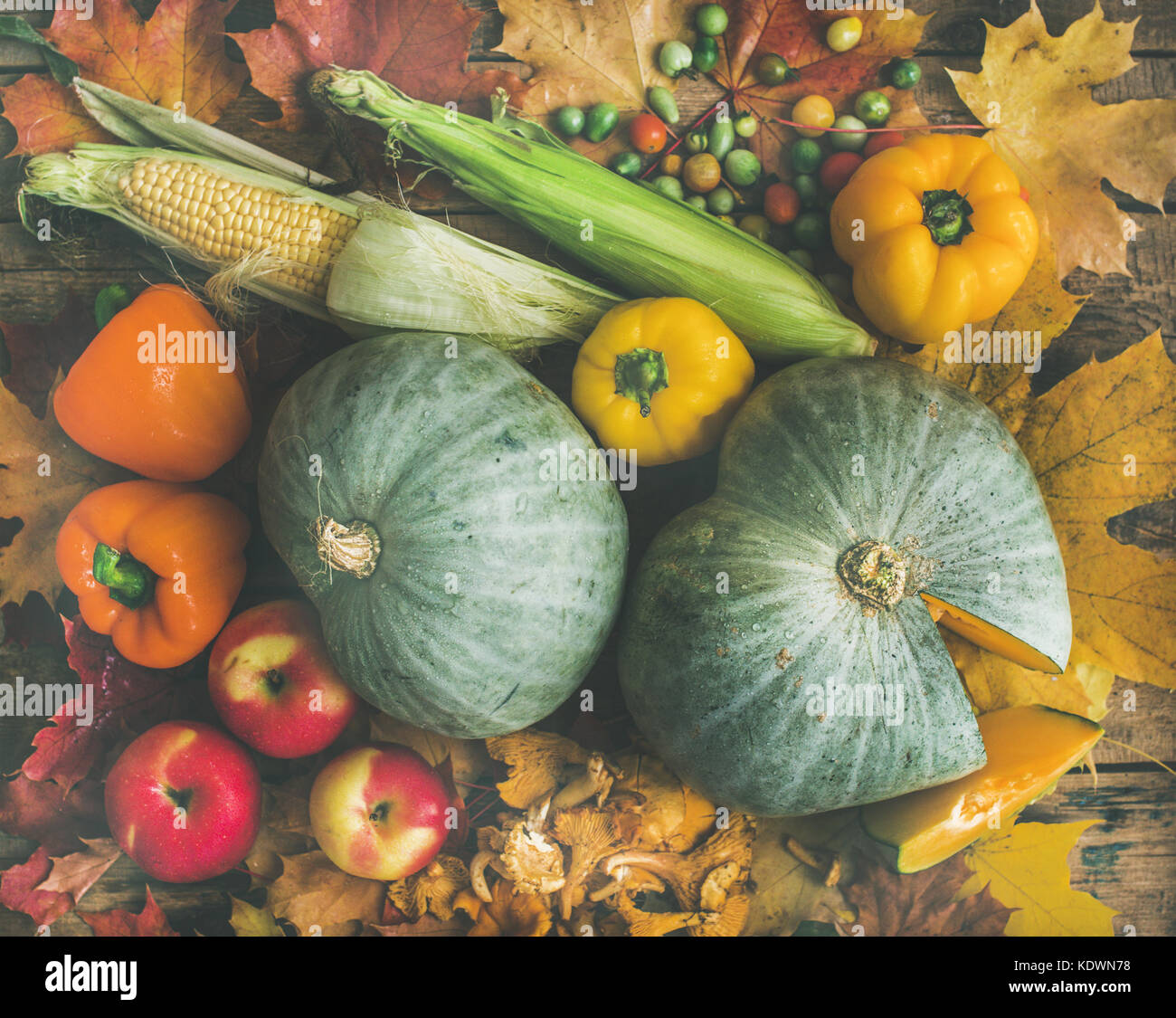 Fall vegetables assortment over wooden table background, top view - Stock Image
