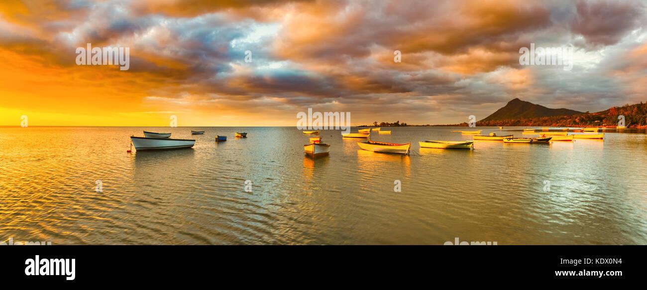 Fishing boats at sunset time. Amazing landscape.. Mauritius. Panorama - Stock Image