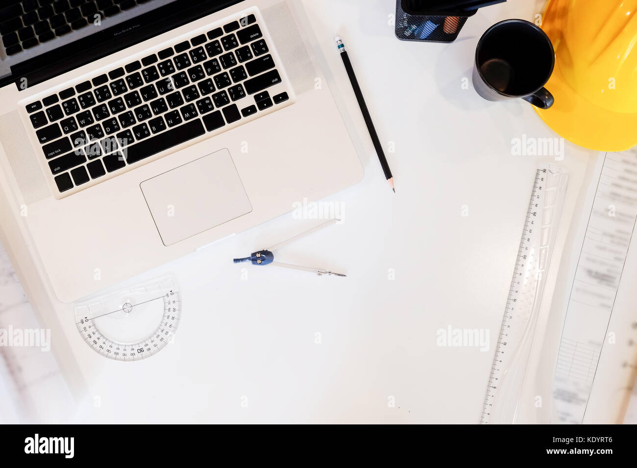 Architecture drawing desk,Business,engineering concept,construction site working with blueprints in the office top - Stock Image
