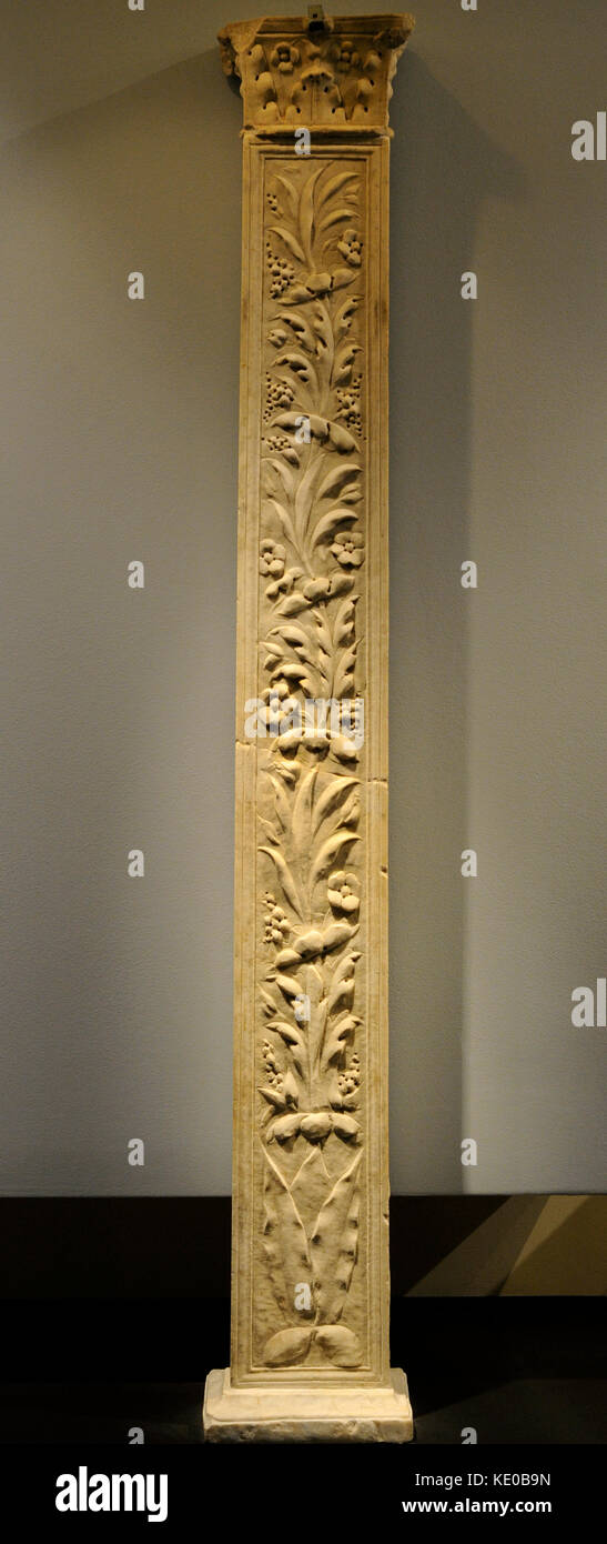 Roman pillar of rectangular base with capital with leaves of acanthus and flowers. Side A, buds with flowers and - Stock Image