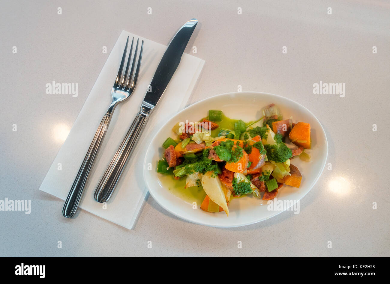 Small plate of sweet potato and turnip, salami, leeks with salsa verde at Nickel & Diner in SoHo in New York - Stock Image