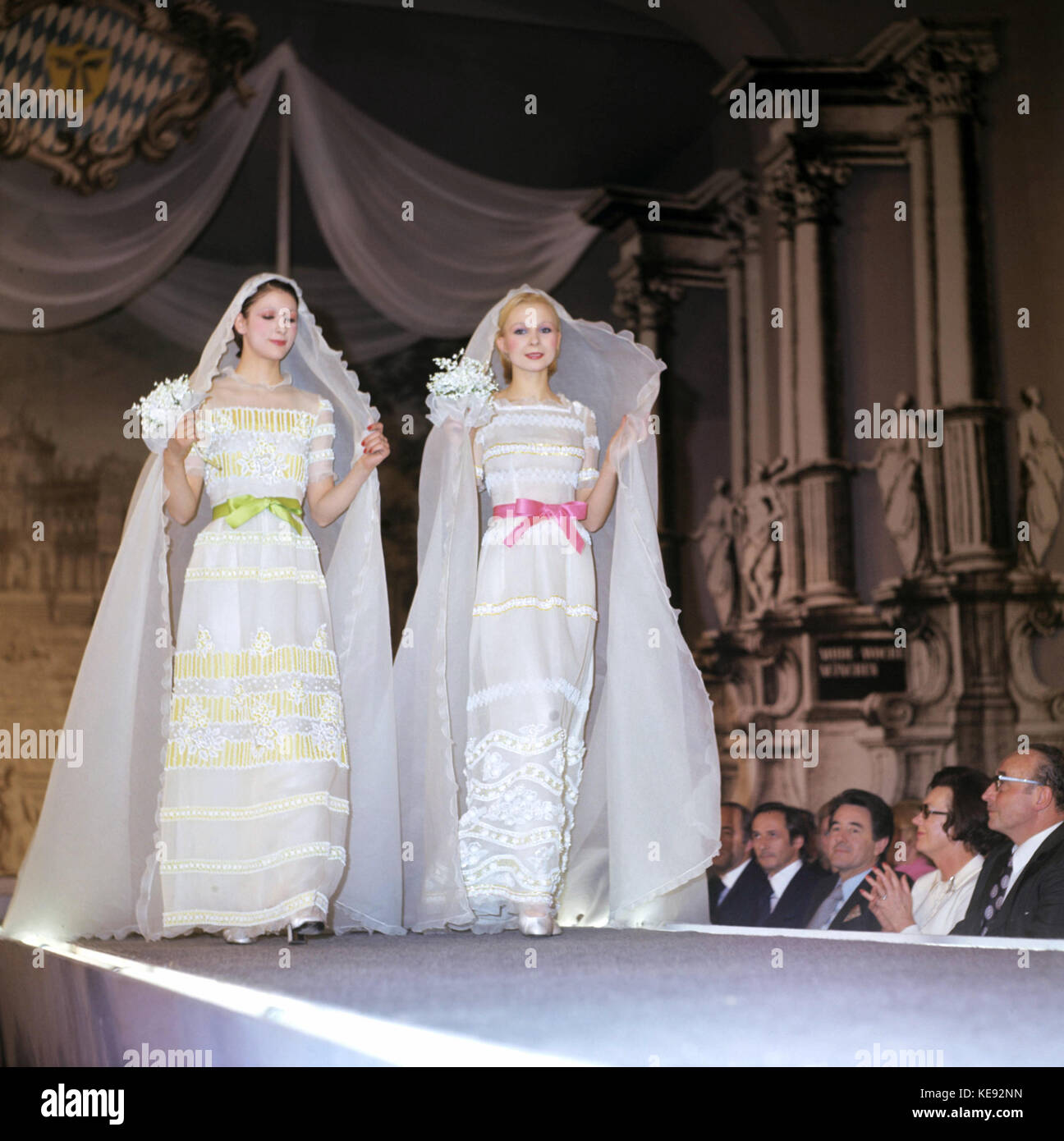 two models wearing dresses by christian dior at a fashion week in