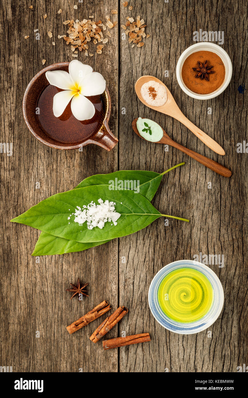 Avocados  leaves with nature spa ingredients dried indian bael ,cinnamon powder ,cinnamon sticks ,aromatic oil ,star - Stock Image